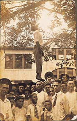 The lynching of  Lige Daniels.  Onlookers, including young boys. August 3, 1920, Center, Texas