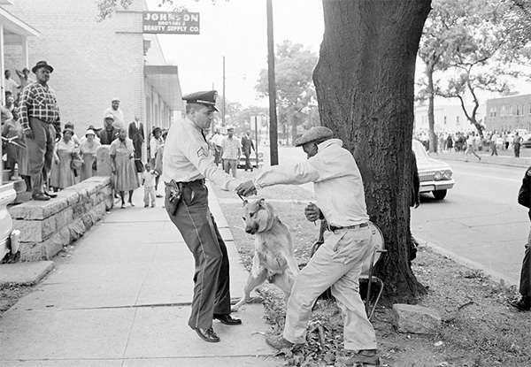 Man with knife attempting to stab police dog birmingham alabama may 3 1963