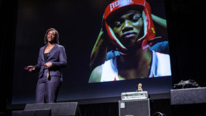 Claressa Shields speaking to youths about her life.