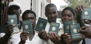 Haitian Immigrants show off their Brazilian passport (Photo via Borgen Magazine)