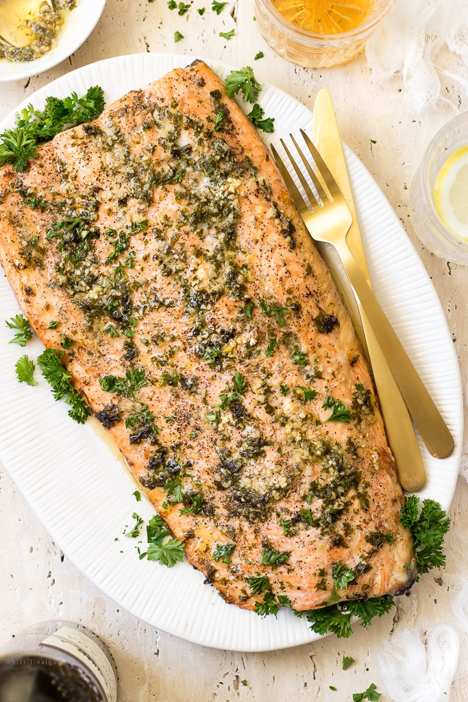 Flaky, tender, buttery melt in your mouth garlic side of salmon is perfect for those midweek dinner emergencies. You'll have dinner ready in 30 minutes or less! This salmon also makes for a quick and easy holiday dinner.