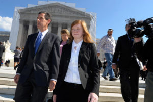 Abigail Fisher and Edward Blum walk outside the Supreme Court in October 2012. (Susan Walsh/AP Photo)
