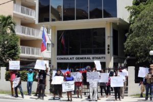 Haitian protesters stand in front of the General Consulate of The Republic of Haiti on Wednesday. Photo credit: Jose A. Iglesias el Nuevo Herald