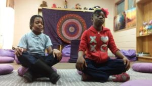 Robert W. Coleman Elementary School students practicing meditation in the Mindful Moment Room. Image courtesy of the Holistic Life Foundation.