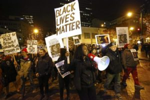 Protesters marching through the streets of Ferguson. Image courtesy of the Seattle Times.
