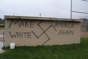 Racist grafitti spray painted on a softball field dugout in Wellsville, NY. Photo courtesy of Brian Quinn/Wellsville Daily Reporter