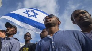 Israelis take part in a demonstration in Tel Aviv called by members of the Ethiopian community against alleged police brutality and institutionalized discrimination, on May 3, 2015. IMAGE: AFP PHOTO/JACK GUEZ (PHOTO CREDIT SHOULD READ JACK GUEZ/AFP/GETTY IMAGES)