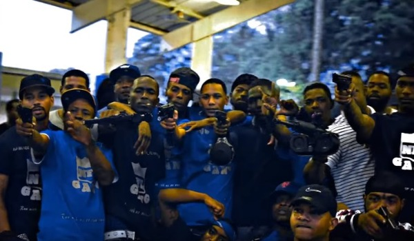 20 men were arrested for flashing illegal guns in a video featuring Maxo Kream and NFL Cartel Bo