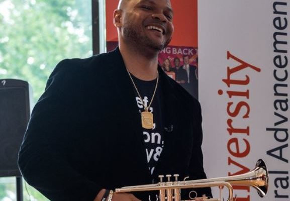 Man laughs with trumpet